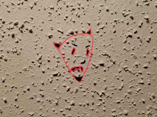 Close up of ceiling texture with Devil's face drawn in.