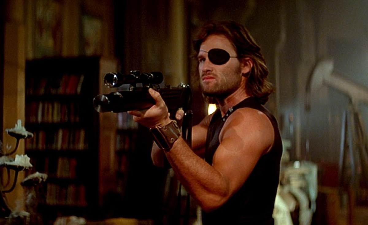 Snake Plissken aiming his uzi using the mounted scope.