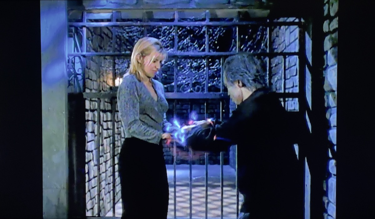 Old Prisoner transferring some static electricity to Linda Masterson.