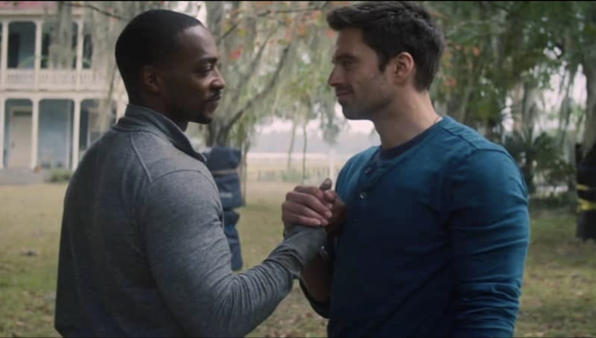 Sam and Bucky holding hands.