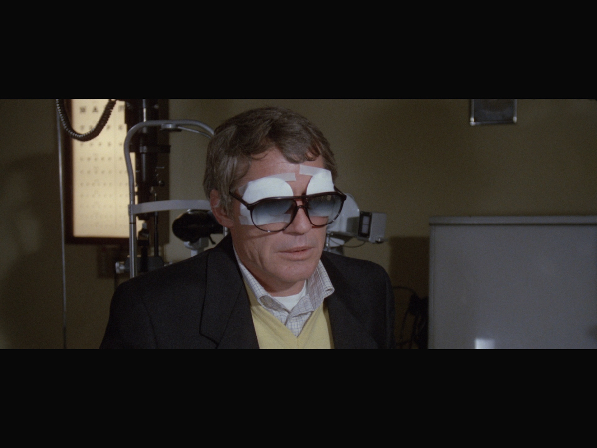 Professor George Hacker wearing eye patches under his glasses.