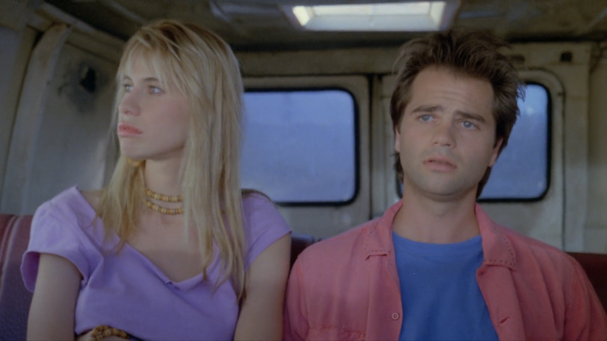 Donna (Elizabeth Kaitan) and Jack (Clayton Rohner) looking disinterested and bored.