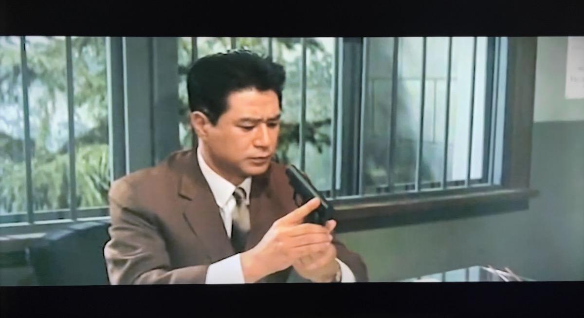 Chief Ito inspecting a gun.