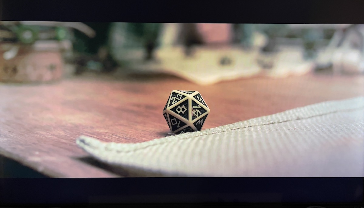 A d20 with 14 showing as the roll.