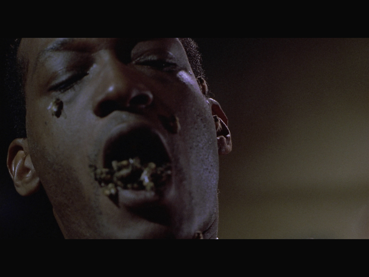 Candyman with bees coming out of his mouth.