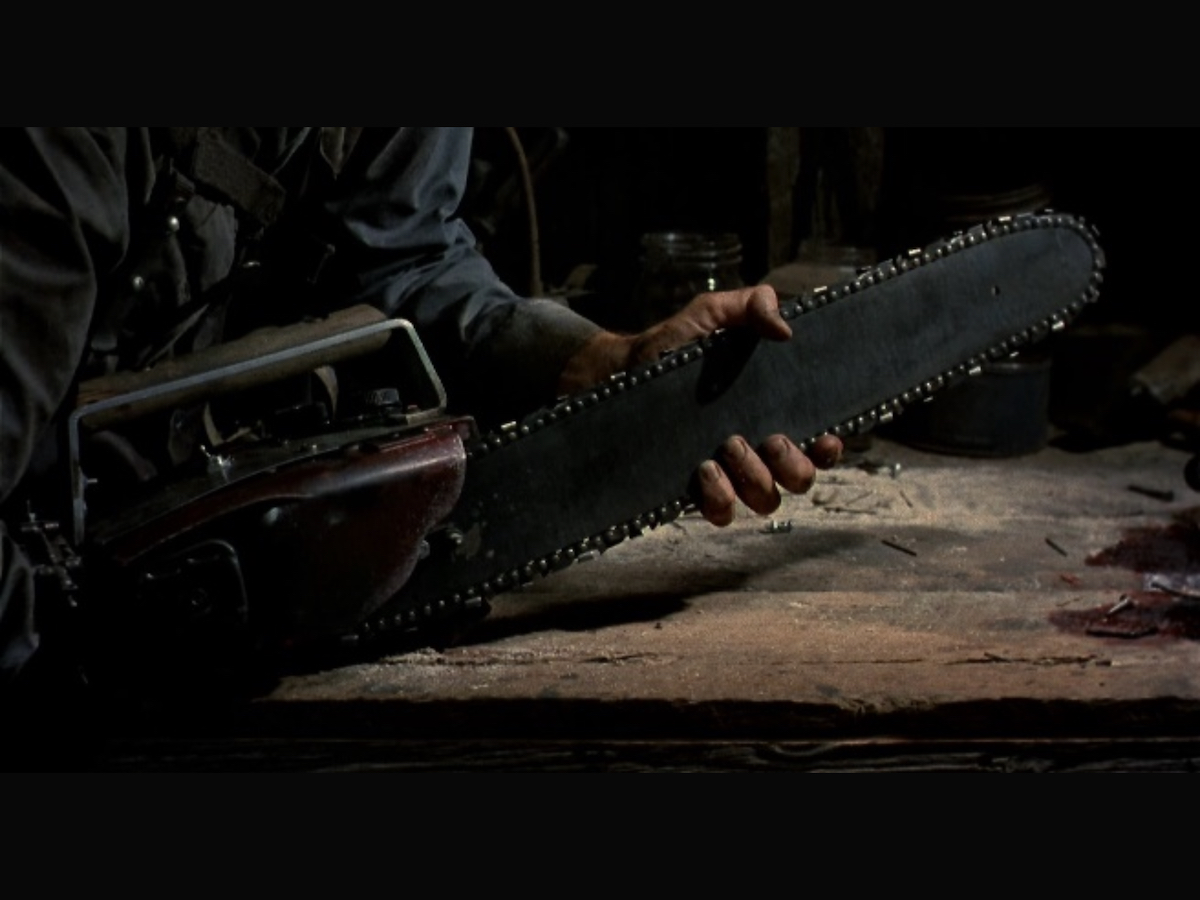 Ash holding the blade of a chainsaw.