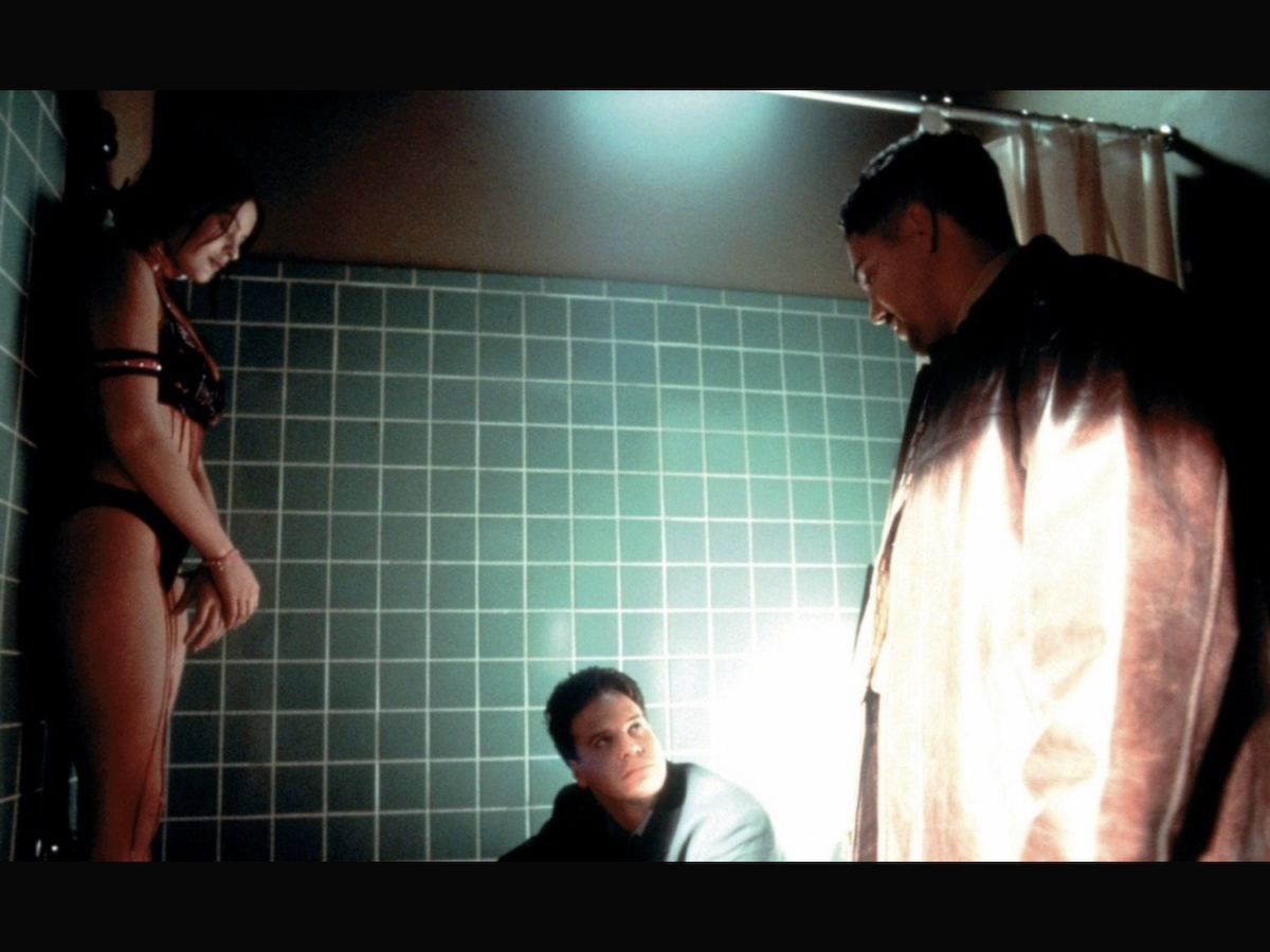 Detectives Joseph and Tony investigating a murdered woman hung from the shower head.